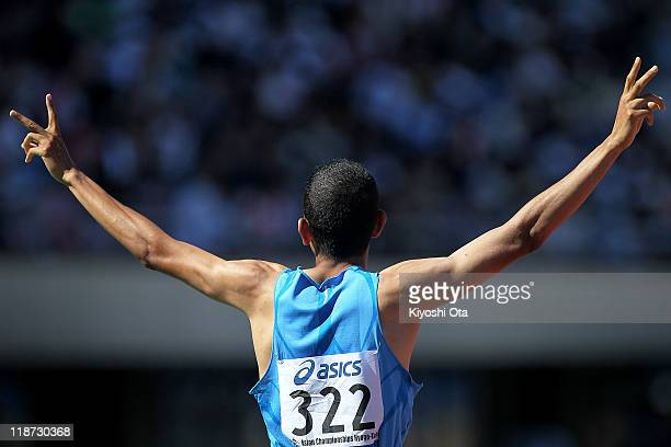 Mohammad AlAzemi of Kuwait celebrates after winning the gold medal in a time of 14614 in the Men's 800m final during the day four of the 19th Asian...