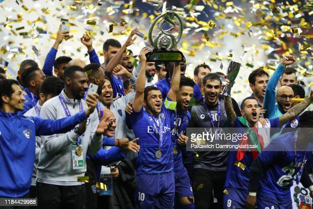 Mohammad AlShalhoub of Al Hilal lift the trophy after the AFC Champions League Final second leg match between Urawa Red Diamonds and Al Hilal at...