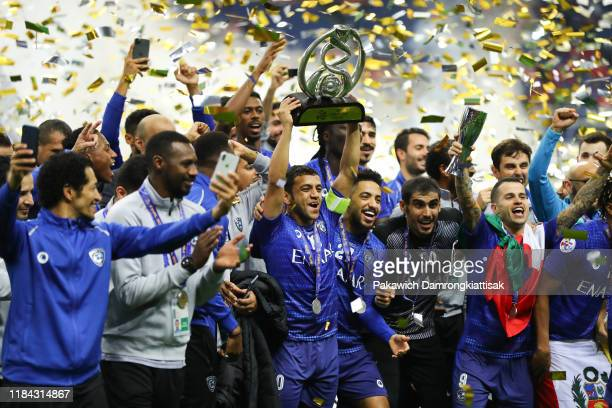 Mohammad AlShalhoub of Al Hilal lifts the trophy after the AFC Champions League Final second leg match between Urawa Red Diamonds and Al Hilal at...