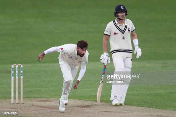 Mohammad Amir of Pakistan bowls as Kent captain Joe Denly looks on during day 1 of the tour match between Kent and Pakistan on April 28 2018 in...