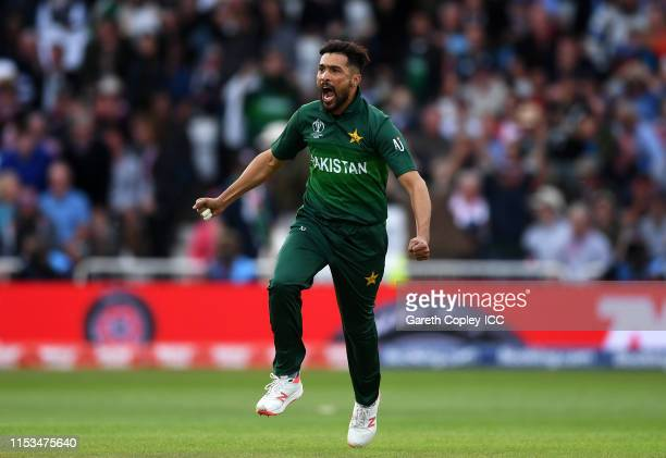 Mohammad Amir of Pakistan celebrates after taking the wicket of Jos Buttler during the Group Stage match of the ICC Cricket World Cup 2019 between...
