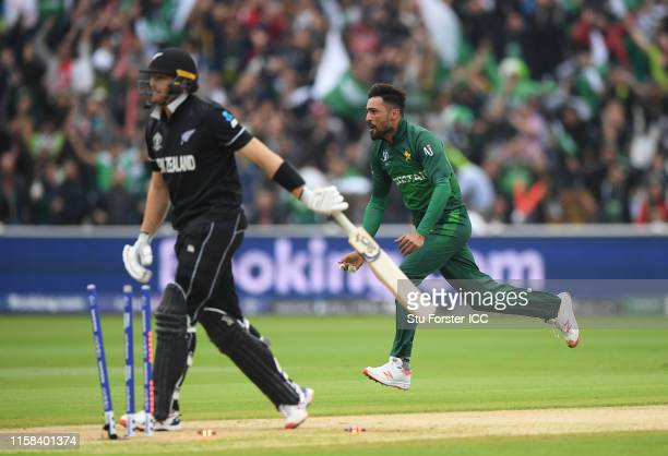 Mohammad Amir of Pakistan celebrates after taking the wicket of Martin Guptill of New Zealand during the Group Stage match of the ICC Cricket World...