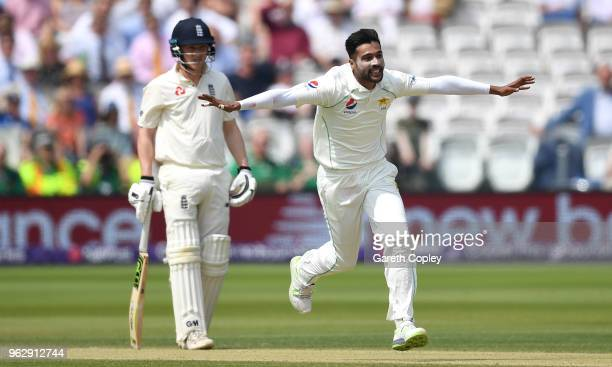 Mohammad Amir of Pakistan celebrates dismissing Mark Wood of England during day four of the 1st NatWest Test match at Lord's Cricket Ground on May 27...