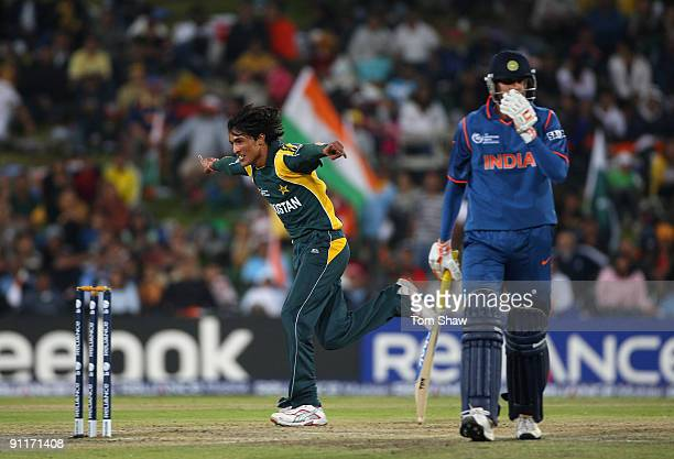 Mohammad Amir of Pakistan celebrates taking the wicket of Yusuf Pathan of India during the ICC Champions Trophy group A match between India and...