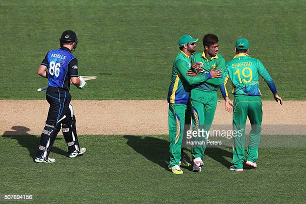 Mohammad Amir of Pakistan celebrates the wicket of Henry Nicholls of the Black Caps during the One Day International match between New Zealand and...