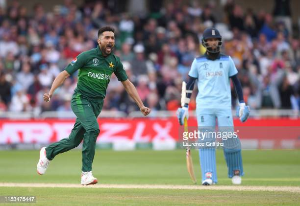 Mohammad Amir of Pakistan celebrates the wicket of Jos Butler of England during the Group Stage match of the ICC Cricket World Cup 2019 between...