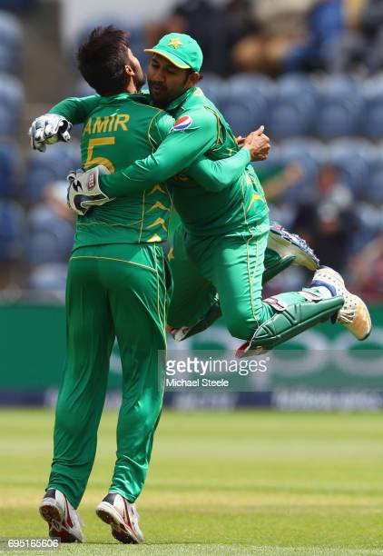 Mohammad Amir of Pakistan celebrates with captain Sarfraz Ahmed after taking the wicket of Niroshan Dickwella of Sri Lanka during the ICC Champions...