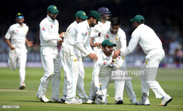 Mohammad Amir of Pakistan celebrates with captain Sarfraz Ahmed after dismissing Dawid Malan of England during day three of the 1st NatWest Test...
