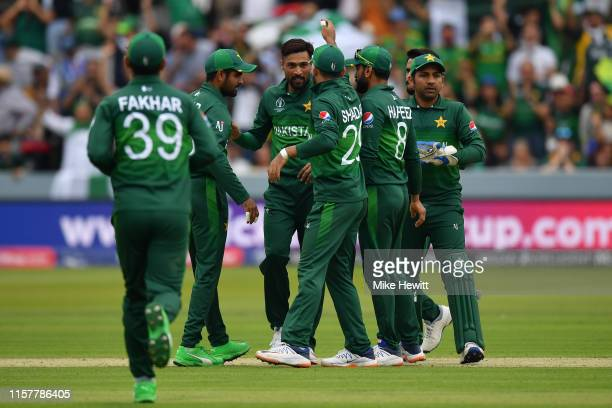 Mohammad Amir of Pakistan celebrates with team mates after dismissing Faf du Plessis of South Africa during the Group Stage match of the ICC Cricket...