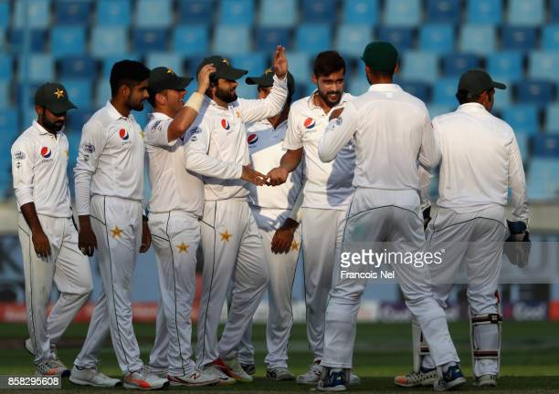 Mohammad Amir of Pakistan celebrates with teammates after dimissing Sadeera Samarawickrama of Sri Lanak during Day One of the Second Test between...