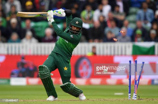 Mohammad Amir of Pakistan is bowled by Mitchell Starc of Australia during the Group Stage match of the ICC Cricket World Cup 2019 between Australia...