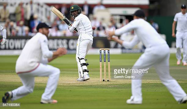 Mohammad Amir of Pakistan is caught out by Joe Root of England during day two of the 1st Investec Test between England and Pakistan at Lord's Cricket...
