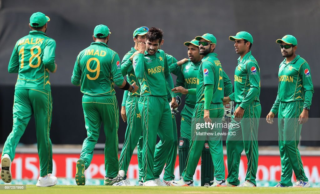 Mohammad Amir of Pakistan is congratulated on the wicket of Shikar Darwan of India, after he was caught by Sarfraz Ahmed during the ICC Champions Trophy Final between Pakistan and India at The Kia Oval on June 18, 2017 in London, England.
