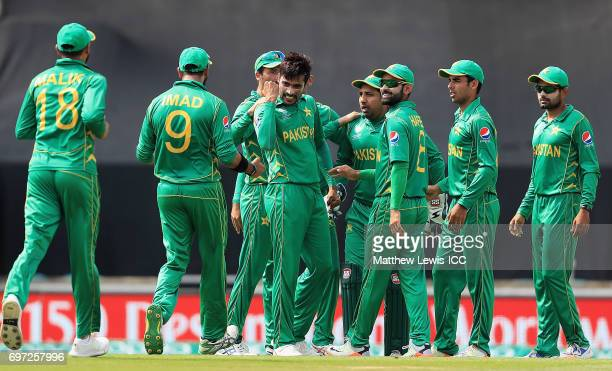 Mohammad Amir of Pakistan is congratulated on the wicket of Shikar Darwan of India after he was caught by Sarfraz Ahmed during the ICC Champions...