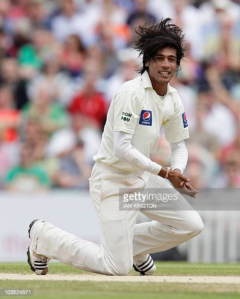 Mohammad Amir of Pakistan reacts after taking the wicket of Stuart Broad of England for 6 runs and his 5th wicket of the match on the fourth day of...