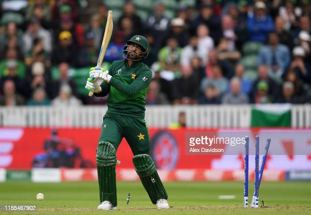Mohammad Amir of Pakistan reacts to being bowled during the Group Stage match of the ICC Cricket World Cup 2019 between Australia and Pakistan at The...