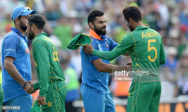 Mohammad Amir of Pakistan shakes hands with Virat Kohli of India after the ICC Champions Trophy final match between India and Pakistan at the Kia...