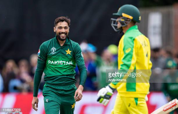Mohammad Amir of Pakistan smiles after dismissing Usman Khawaja of Australia during the Group Stage match of the ICC Cricket World Cup 2019 between...