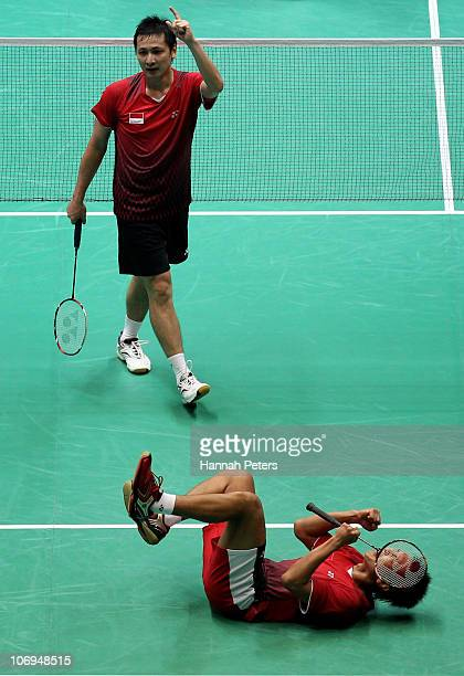 Mohammad Ashan and Alvent Yulianto Chandra of Indonesia celebrate victory in the Men's Doubles Badmington Quarterfinal Match against Chen Zu and...