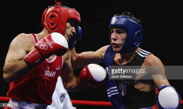 Mohammad Asheri of Iran and Domenico Valentino of Italy in action during the men's boxing 57 kg preliminary bout on August 20 2004 during the Athens...