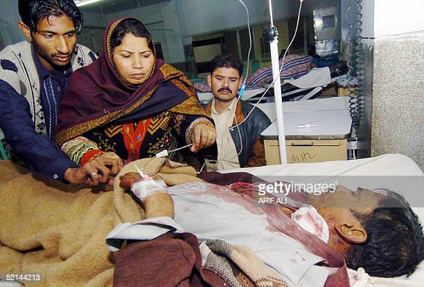Mohammad Ashraf an injured Pakistani man lies on a hospital bed after being injured by a metal wire used to fly a kite during the Basant festival in...