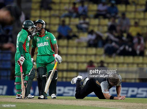 Mohammad Ashraful and Mushfiqur Rahim of Bangladesh laugh as Jacob Oram of New Zealand lays on the ground during the ICC World T20 Group D match...