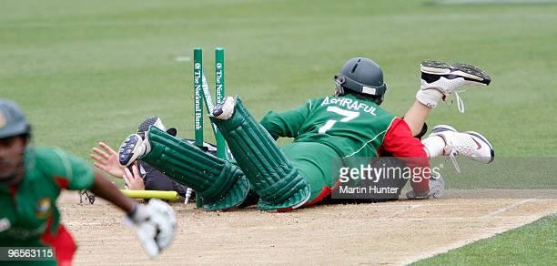Mohammad Ashraful of Bangladdesh crashes into Martin Guptill of New Zealand during the third One Day International match between the New Zealand...