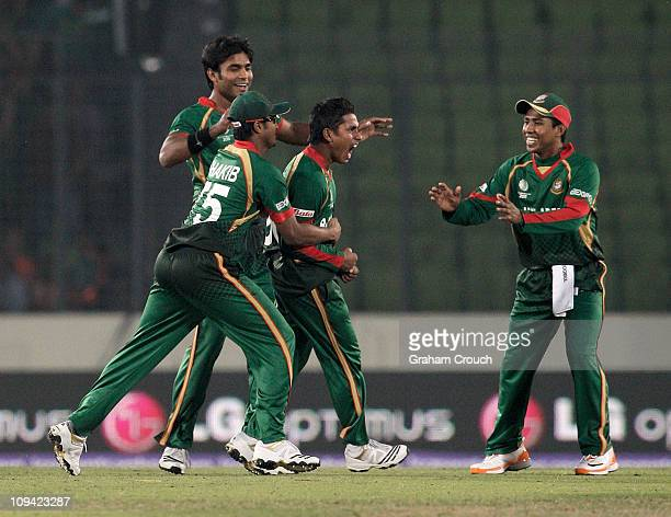 Mohammad Ashraful of Bangladesh celebrates his caught and bowled of Ed Joyce of Ireland during the 2011 ICC World Cup Group B match between...