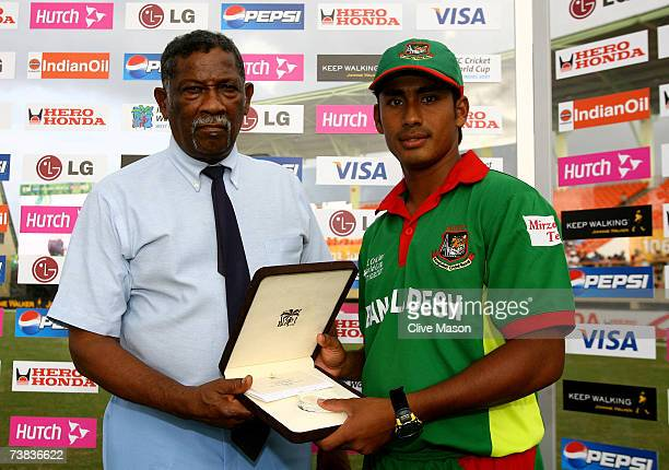 Mohammad Ashraful of Bangladesh poses with his man of the match award after the ICC Cricket World Cup Super Eights match between Bangladesh and South...