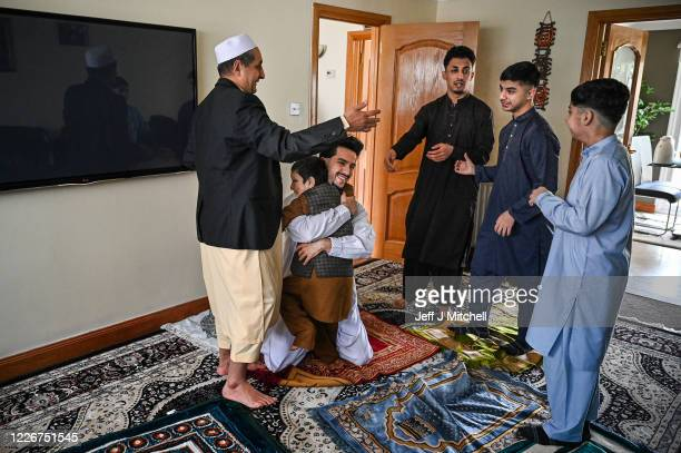 Mohammad Asif and his sons Harun Rohid Sahil Faqrhan and Sudias gather at their home to perform Eid AlFitr prayer after a month of fasting in the...