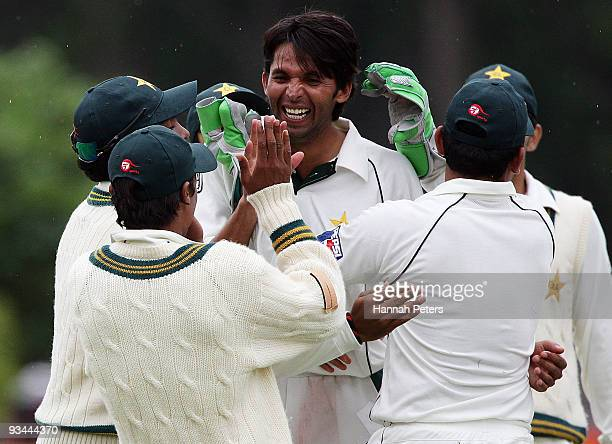 Mohammad Asif of Pakistan celebrates claiming the wicket of Brendon McCullum of New Zealand during day four of the First Test match between New...