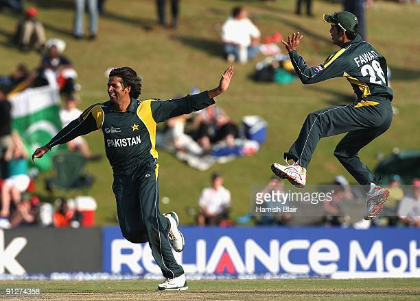Mohammad Asif of Pakistan celebrates the wicket of Cameron White of Australia with team mate Fawad Alam during the ICC Champions Trophy Group A match...