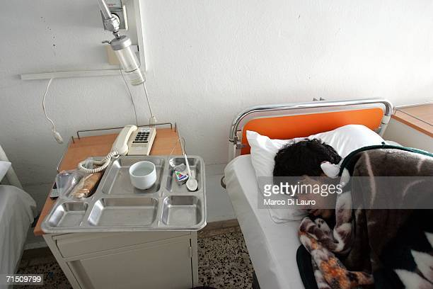 Mohammad Berry 21yearsold of the Lebanese Red Cross recovers in his hospital bed after being injured when an Israeli aircraft hit the ambulance he...