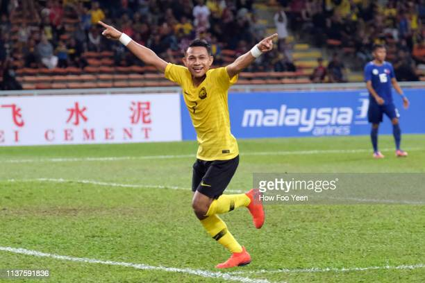 Mohammad Faisal Halim of Malaysia celebrates after scoring during the AFC U23 Championship qualifier between Malaysia and Philippines at Shah Alam...