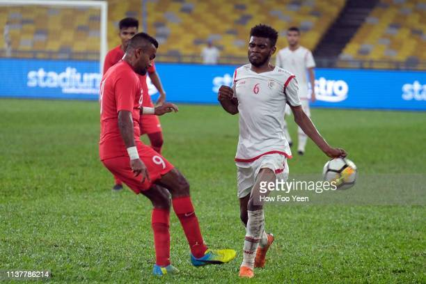 Mohammad Faritz of Singapore and Raed Ibrahim Saleh of Oman in action during the Airmarine Cup final between Singapore and Oman at Bukit Jalil...