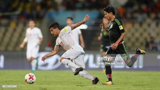 Mohammad Ghaderi of Iran is challenged by Diego Lainez of Mexico during the FIFA U17 World Cup India 2017 Round of 16 match between Iran and Mexico...