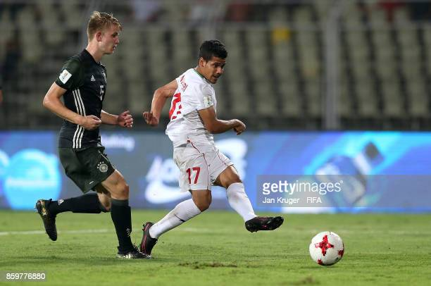 Mohammad Ghaderi of Iran sees his shot at goal go wide under pressure from Jan Boller of Germany during the FIFA U17 World Cup India 2017 group C...