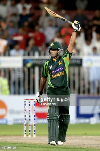 Mohammad Hafeez celebrates after reaching his century during the first OneDay International match between Sri Lanka and Pakistan at the Sharjah...
