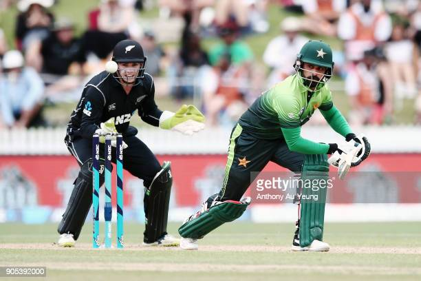Mohammad Hafeez of Pakistan bats as Tom Latham of New Zealand looks on during game four of the One Day International Series between New Zealand and...