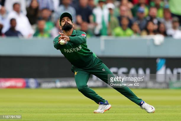 Mohammad Hafeez of Pakistan catches out Rassie van der Dussen of South Africa during the Group Stage match of the ICC Cricket World Cup 2019 between...