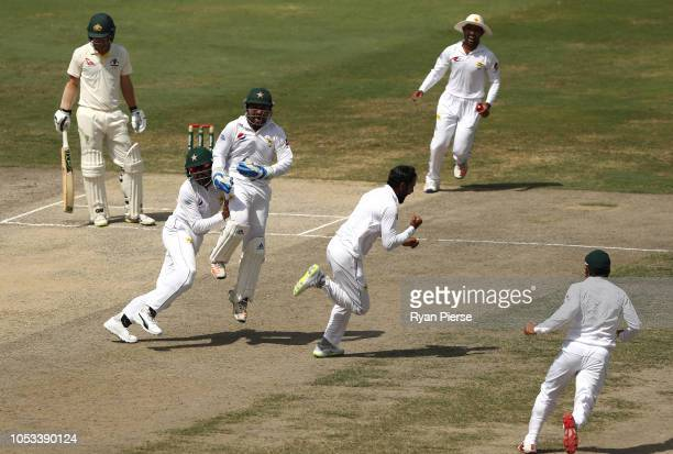 Mohammad Hafeez of Pakistan celebrates after taking the wicket of Travis Head of Australia during day five of the First Test match in the series...