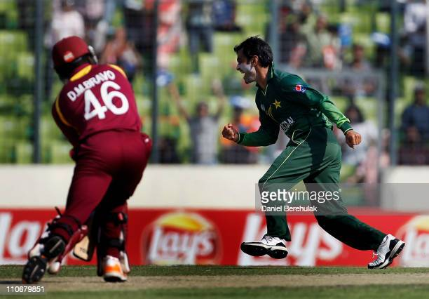 Mohammad Hafeez of Pakistan celebrates after taking the wicket of Darren Bravo of West Indies during the 1st quarterfinal of the ICC Cricket World...