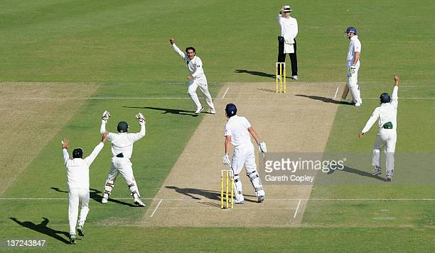 Mohammad Hafeez of Pakistan celebrates dismissing Alastair Cook of England during first Test match between Pakistan and England at The Dubai...