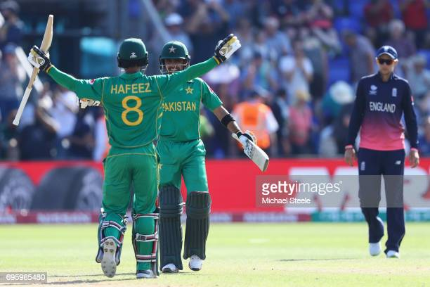 Mohammad Hafeez of Pakistan celebrates hitting the winning runs with Babar Azam and victory by 8 runs during the ICC Champions Trophy SemiFinal match...