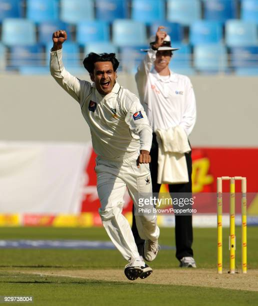Mohammad Hafeez of Pakistan celebrates the dismissal of England batsman Alastair Cook for 3 runs in the 1st Test match between Pakistan and England...