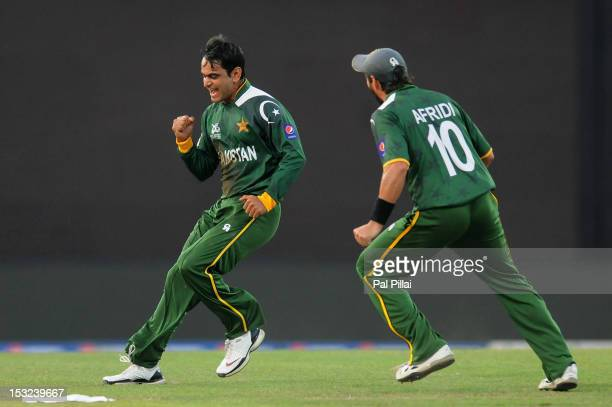 Mohammad Hafeez of Pakistan celebrates the wicket of David Warner of Australia during the ICC World Twenty20 2012 Super Eights Group 2 match between...
