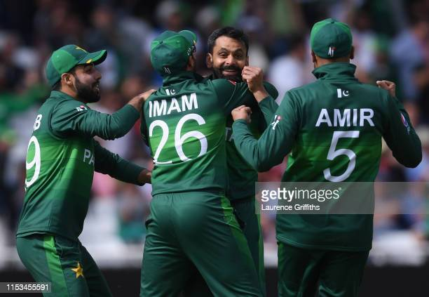 Mohammad Hafeez of Pakistan celebrates the wicket of Eoin Morgan of England during the Group Stage match of the ICC Cricket World Cup 2019 between...