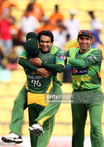 Mohammad Hafeez of Pakistan celebrates with teammate after taking the wicket of Sri Lankan batsman Kumar Sangakkara during the second one day...