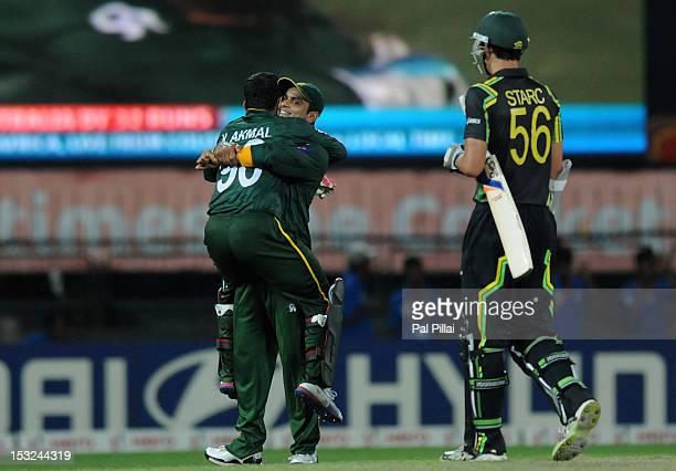 Mohammad Hafeez of Pakistan celebrates with teammate Kamran Akmal after winning the ICC World Twenty20 2012 Super Eights Group 2 match between...