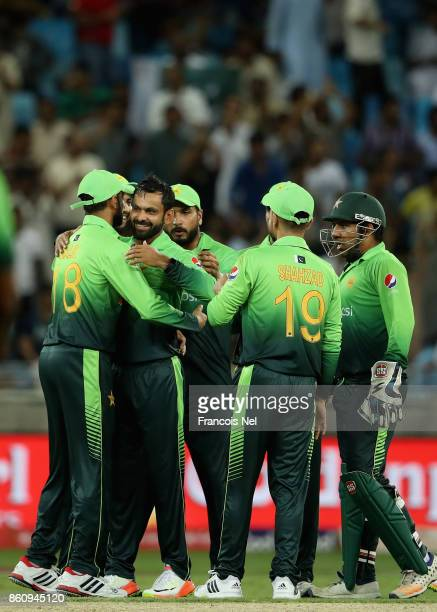 Mohammad Hafeez of Pakistan celebrates with teammates after dismissing Upul Tharanga of Sri Lanka during the first One Day International match...
